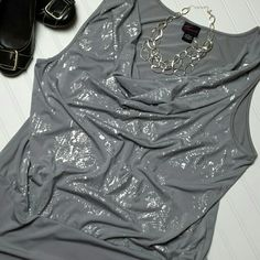 """Torrid Plus Size 3 Silver Foil Sparkle Tank Top Perfect for a party or date night! This sexy Torrid top has a scoop cowl neck, banded bottom with ruched sides, and an eye-catching silver foil """"splatter"""" snakeskin print effect on the front.   95% polyester, 5% spandex, great stretch.  * MEASUREMENTS *  Armpit-to-armpit: 24"""". Across the bottom: 22"""". Length shoulder to bottom: 29"""".  * CONDITION *  Excellent gently-worn condition. I find no snags, stains, or other blemishes. Non-smoking…"""