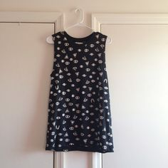 Zara Trafaluc Black Eye Tank In like new condition. Item contains tiny mark on inside of top (photo 4) but is not noticeable when wearing. Zara Tops Muscle Tees