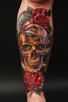 I like the photorealism of the skull combined with the almost cartoonish new-school snake and flowers.  By Uncle Allan at Conspiracy Inc.
