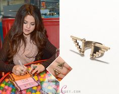Selena Gomez held a Unicef Dessert Party at Dylan's Candy Bar in NY over the weekend. She wore a With Love From CA Pyramid Ring in color Antique Gold. You can purchase this ring from Pacsun.com for a hot $8.50!  Buy it HERE  She's also wearing a Free People top. We're still looking for her scarf and other ring.