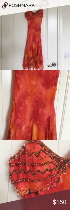 Beaded dress Perfect for a formal, pageant, wedding, or vacation! Pre loved but in great condition. Beaded on bust. Built in cups. Thread where padded was sown in, please see photos. Handkerchief hem. Zipper closure. Originally purchased from Saks. Sue Wong Dresses