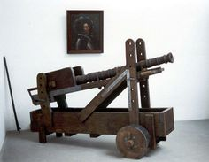 Wrought iron cannon found in the 1960s in St. Wendel, Germany on a modern reconstructed carriage. Barrel 2nd half of 15th century. In the background a portrait of Franz von Sickingen.
