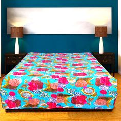 Buy Cotton Bed Sheet online in India at very affordable price with carpetandtextile.com. This double size cotton bed sheet comes with the turquoise, pink, brown colors.