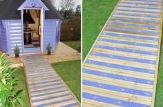 Colourdec bayside non-slip decking strips on garden summerhouse pathway.
