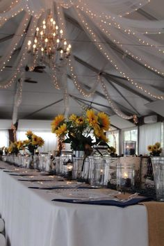 Long tables, burlap and sunflowers- reception tent