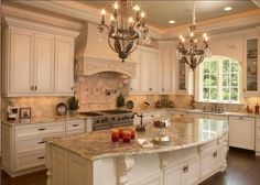 Photo of The Rock Prefab Granite Outlet - San Diego, CA, United States. Stunning French country kitchen, Sienna Brûlée Granite slab with 4x4 tumbled bottocino marble .