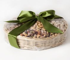 Flavor Fanfare Gift Basket, Fastachi: This basket is packed with nuts hand roasted in small batches, in addition to Fastachi's Harvest Nut Mix and its signature Cranberry Nut Mix.