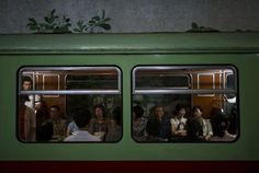 """fotojournalismus: """" Commuters ride on a subway train at Yonggwang station, or…"""