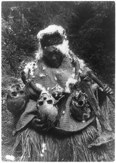 A Kwakiutl Native American dancer in ceremonial costume with human skulls and bones. Photograph by Edward Curtis, c1911.