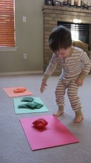 Color toss. Use our bean bags, get big pieces of construction paper in coordinating colors, have the kids stand away from the paper and toss the right colors onto the right paper colors. Kind of like a flat, color-oriented corn hole game!