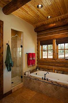 Master bathroom has a rustic feel with white cedar interior finish and chinking