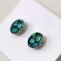 Green is nice. Hot of the press pretty stud earrings in green from Vivid Sister