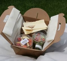 "Recyclable Picnic Hamper Set (4 people) A lightweight, recyclable and biodegradable take-away picnic box, including a fixed integral tablecloth which folds out to provide a convenient and hygienic eating area.  4 Sugar Bagasse Plates 9"" 4 Sugar Bagasse Bowls 4 Cornstarch Cups 12oz Set of 4 Birch Knives/Forks/Spoons 4 Napkins 2 Sugar Bagasse Rectangular Food Storage Containers with Lids 17cm x 12cm x 5cm (500ml) 2 Sugar Bagasse Deli Pots with Lids (340ml)  All you need to do is add the food…"
