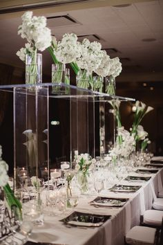 Table with Modern Floral Design | Photo: Shaun Menary Photography. View More:  http://www.insideweddings.com/weddings/modern-black-and-white-wedding-with-southern-traditions-in-dallas/916/