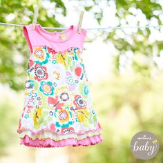 Now on sale! Toddler girl flower print dress that's soft as hug - from Hallmark Baby.