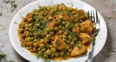 Chicken stew with peas by Sebastian_Studio. Chicken stew with peas, carrot and tomato sauce on plate with chopped dill and a fork Buy Chickens, Ratatouille, Tomato Sauce, Chana Masala, Stew, Carrots, Plates, Ethnic Recipes, Studio