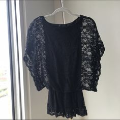 Beautiful Lace Black Top Excellent condition. Tight fitted inner with a loose arms to make a beautiful unique classy look Tops