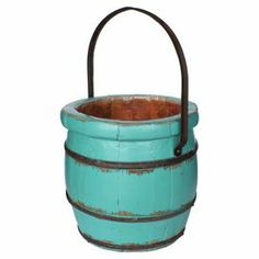 """Distressed wood bucket in turquoise with an iron handle.  Product: BucketConstruction Material: Wood and ironColor: TurquoiseFeatures:  HandcraftedMakes for a great accent piece Dimensions: 11"""" H x 12"""" DiameterCleaning and Care: Using a clean wash cloth, rub the item with lemon oil until polished"""