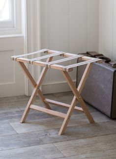 When an extra surface is needed. Stow luggage on this handy fold out rack or place trays on top for extra entertaining.