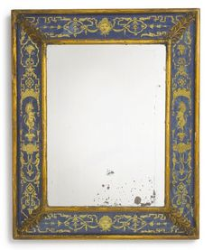 A Northern European giltwood and verre églomisé mirror second quarter 20th century height 24 in.; width 19 3/4 in. 61 cm; 50 cm