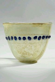 .ROMAN GLASS GOBLET WITH BLUE BLOBS NEW YORK | VESSELS   DATE:  3rd Century AD, 4th Century AD CULTURE:  Roman