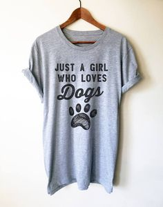 Click to get 20% off this cute Just A Girl Who Loves Dogs shirt. For Black Friday weekend only! Use Coupon code BLACKFRIDAY at checkout!   This awesome shirt is the perfect gift for dog lovers, dog owners, dog trainers, service dog owners and any dog fan! #doglovers #doglovergifts #dogshirt #funnydogquotes #dogowner #dogclothes #dogapparelaccessories