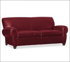 Oo-la-la! Love this red leather sofa!