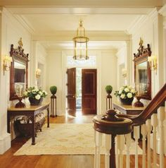 """Thomas Pheasant upgrades a Colonial Revival House: """"The key was to transform it into a family residence without losing its sense of history,"""" Entrance hall Oushak rug. Architectural Digest, Entry Foyer, Entryway Decor, Architecture Classique, Interior Decorating, Interior Design, Interior Architecture, Foyer Decorating, Luxury Interior"""