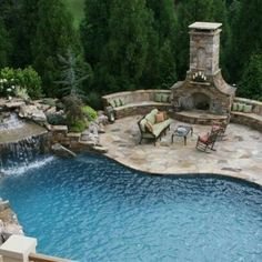 Backyard oasis with swimming pool and outdoor fireplace