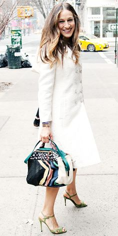 On her way to the launch of her new shoe collection, Parker was all smiles in a white brocade Dolce & Gabbana coat that she accessorized with a playful multicolored patchwork Jerome Dreyfuss bag and green sandals from her collection.