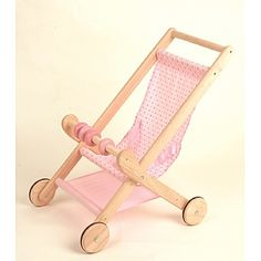 Wish I had known about this cute wooden doll stroller back when I ...