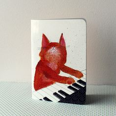 Greeting card - Ginger cat playing piano.