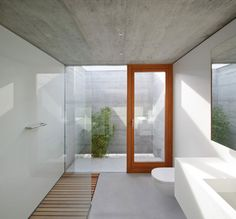 Trendy Simple Home Ideas in Beautiful Nuance: Attractive Bathroom In The House With White Vanity And The Glass Shower Space Near Glass Walls ~ SFXit Design Architecture Inspiration