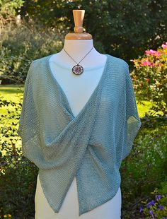 Ravelry: Twisted pattern by Susan Barstein.  Very easy....knit 2 rectangles, twist and sew together