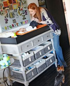 Very cool change table idea!! With the addition of a bumper, a ready-made console became a changing table for Cash, who admires the graphic charm of the alphabet needlepoint on the nearby wall.