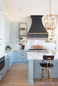 Designer tips on styling open kitchen shelving! How to select the best accessories for your space... kitchen-white-marble-calcutta-gold-open-shelves-gold-black-vent-hood-blue-gray-cabinets-shaker-style-black-chevron-tile-subway-white-backsplash-decor-ideas-5-of-32