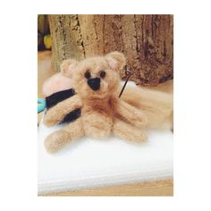 Made from Felt wool. Teddy bear.