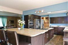 Large kitchen design complete with island and breakfast bar.-Home and Garden Design Ideas
