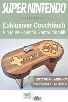 Du bist auf der Suche nach dem ultimativen Highlight für deinen Gamingroom? Dieser Super Nintendo Tisch aus Holz massiv ist das absolute Must-Have für jeden Retro-Nerd! Der grandiose Massivholztisch wird hochqualitativ aus edlem Holz in unserer Tischlermeisterbetrieb gefertigt und exklusiv über den Webshop vertrieben. Individuelle Anpassungen sind unsere große Stärke. Sowohl als Cochtisch als auch als Wandbild aus Holz erhältlich. #mmw #holzmöbel #gaming #supernintendo Super Nintendo, Alter Computer, Nerd, Patio Tables, Playroom Table, Made To Measure Furniture, Carpentry, Wood Ideas, Searching