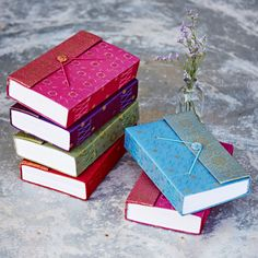 These stunning handmade, fair trade and eco-friendly sari journals are covered with vibrant sari fabric and bound with handmade paper. Fabric Journals, Diy Notebook, Sari Fabric, Fabric Gifts, Fair Trade, The Book, Vibrant Colors, Colours, Charity