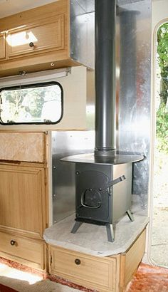 Small wood stove in camper. Would probably work better than the furnace we have - interiors-designed.com                                                                                                                                                                                 More