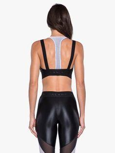 c5fd1dc5c Evanesce™ nylon sports bra in midnight blue. Scoop neck front. Black  shoulder straps