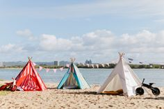 Three of Mocka's Kids Teepees by the beach. Perfect for both inside the home and outside in the garden or at the beach. Kids love playing in their Mocka Teepee. Available in additional colours/designs.