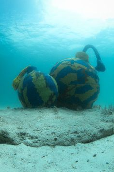 "Olek's ""Time Bomb""  --  Olek is making waves w/ her latest eco-installation ... what do you think? #yarnbomb #crochet"
