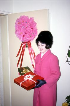 Mom: Here's me with the poofy door to match the poofy present. Do you want to know about the hat?  Me: Yes.  Mom: I hate to [laughs]. Well I would not buy a hat like that today. It was black fox, very chic, and I guess that's all.     Work from home and advertise for us. Great opportunity to make a full time income working part time.