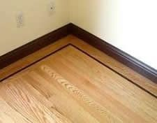 Hardwood floor border on room perimeter with contrasting stain