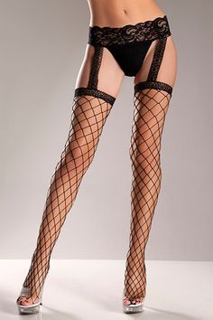 Black Fence Net Garterbelt:Like the look of a garterbelt without all the lumps and adjusting? These are your answer! They are wide black fence net stockings with an attached faux lace garter belt. 98 percent nylon 2 percent spandex. Fits 90-160 lbs. $8.99