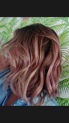 Rose gold , medium length hair