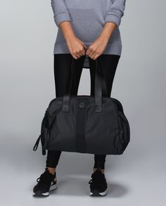 Carrying our gym bag, yoga mat and purse around all day makes us feel scattered. We streamlined things with a bag that stores our clothes and laptop, plus an external strap to secure our mats. Because keeping thing simple helps us stay Zen inside and outside the studio.