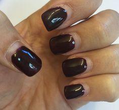 Dark red gel nails.